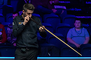 Mark Selby checking his cue ahead of the final frame of the Quarter Final between Ronnie O'Sullivan vs Mark Selby during the 19.com Home Nations Scottish Open at the Emirates Arena, Glasgow, Scotland on 13 December 2019