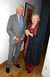 Former newsreader SANDY GALL and his wife ELEANOR GALL at the opening of the exhibition 'Lawrence of Arabia: The Life, The Legend' at the Imperial War Museum, Lambeth Road, London SE1 on 11th October 2005.<br /><br />NON EXCLUSIVE - WORLD RIGHTS