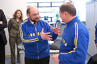 12 JAN 2004, BERLIN/GERMANY:<br /> Martin Schulz (L), SPD Spitzenkandidat, und Olaf Scholz (R), SPD Generalsekretaer, im sportlichen Dress der SPD Wahlkampfhelfer, waehrend einer Besichtigung  der SPD Europa Kampa, Wahlkampfzentrale fuer die Wahl des Europaeischen Parlamentes, anlaesslich der Eroeffnung des Wahlkampfes, Willy-Brandt-Haus<br /> IMAGE: 20040112-02-041<br /> KEYWORDS: Eröffnung, Eroeffnung