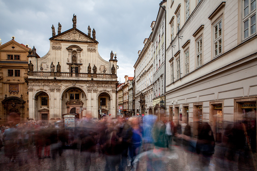 """Crowds are moving from the end of Charles Bridge at """"Krizovnicke Square"""" towards """"Karlova street"""" which leads to Old Town Square."""