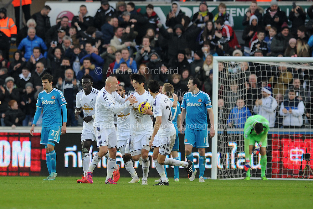 Swansea city players celebrate their 1st goal scored by Ki Sung-Yueng © to make it 1-1.  Barclays premier league match, Swansea city v Sunderland at the Liberty stadium in Swansea, South Wales on Saturday 7th Feb 2015.<br /> pic by Andrew Orchard, Andrew Orchard sports photography.