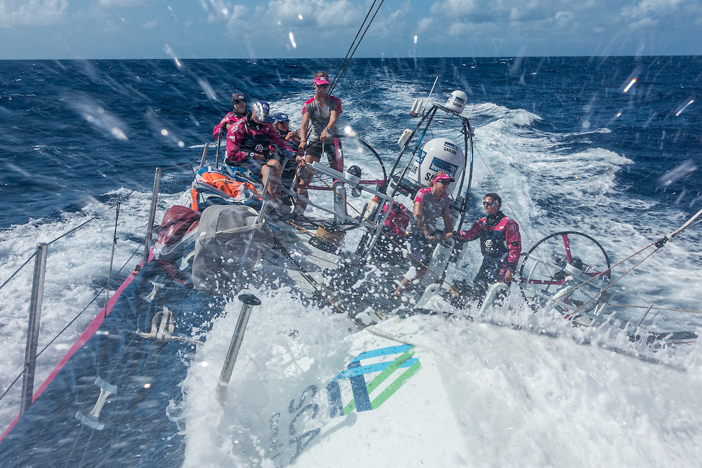 April 27, 2015. Leg 6 to Newport onboard Team SCA. Day 8. A wave crashes over the combing and into the cockpit. 'Welcome to the Doldrums?'