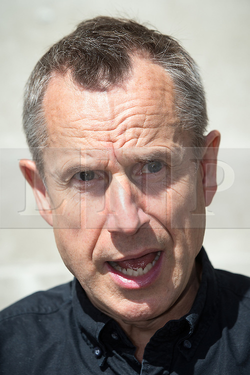 © Licensed to London News Pictures . 06/07/2016 . London , UK . JEREMY HARDY at Stop the War protest outside the venue as the report is delivered . Scene outside the Queen Elizabeth II Conference Centre in Westminster , ahead of the publication of the Chilcot Inquiry's report in to the 2003 invasion of Iraq . Photo credit : Joel Goodman/LNP
