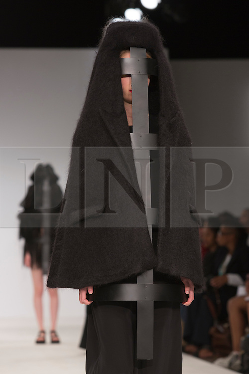 © Licensed to London News Pictures. 30/05/2015. London, UK. A model walks the runway during the Birmingham City University fashion show at Graduate Fashion Week 2015 wearing the collection of graduate student Sarah Grose. Graduate Fashion Week takes place from 30 May to 2 June 2015 at the Old Truman Brewery, Brick Lane. Photo credit : Bettina Strenske/LNP
