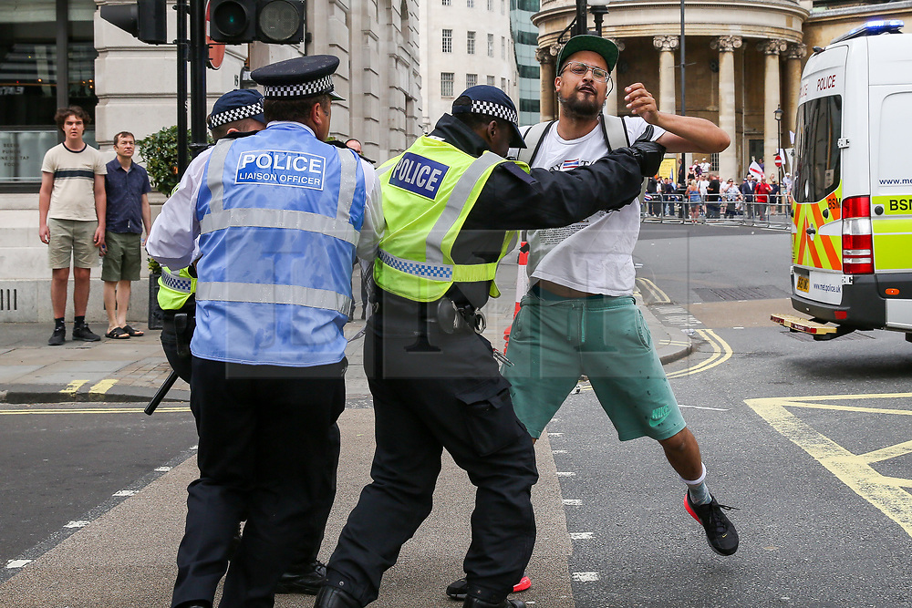 """© Licensed to London News Pictures. 03/08/2019. London, UK. Police detain a protester during """"Free Tommy Robinson"""" protest in central London. Last month Tommy Robinson was given a nine-month prison sentence at Old Bailey after he was found guilty of contempt of court.. Photo credit: Dinendra Haria/LNP"""