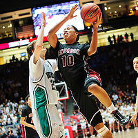 031413  Adron Gardner/Independent<br /> <br /> Shiprock Chieftain Kevin Aspaas (10) passes Hope Christian Husky Dedrick Milford (23) for a shot attempt during the 3A New Mexico High School Basketball tournament semifinals at The Pit in Albuquerque Friday.