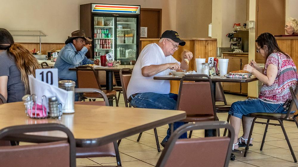 Locals eating at Mexican restaurant, Hondo, Texas, USA