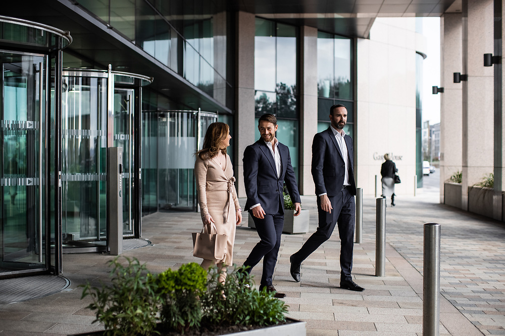 Work colleagues walking out of Gaspe House, a corporate office in the offshore banking and finance area of St helier, Jersey, CI