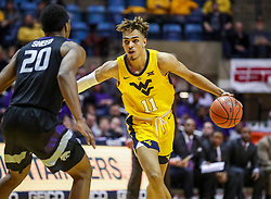Feb 18, 2019; Morgantown, WV, USA; West Virginia Mountaineers forward Emmitt Matthews Jr. (11) dribbles during the second half against the Kansas State Wildcats at WVU Coliseum. Mandatory Credit: Ben Queen-USA TODAY Sports