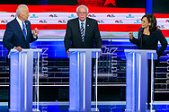 Democratic presidential candidates former Vice President Joe Biden, Sen. Bernie Sanders (I-VT) and Sen. Kamala Harris (D-CA) speak during the first primary debate for the 2020 elections at the Adrienne Arsht Center for the Performing Arts in downtown Miami on Thursday, June 27, 2019.