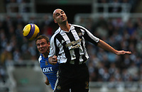 Photo: Andrew Unwin.<br /> Newcastle United v Portsmouth. The Barclays Premiership. 26/11/2006.<br /> Newcastle's Antoine Sibierski (R) wins an aerial ball.