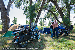 Marcy Linke of Omaha, NE poses with her husband Bryce Bo Bowman at the Glencoe Campground during the annual Sturgis Black Hills Motorcycle Rally. SD, USA. August 7, 2014.  Photography ©2014 Michael Lichter.