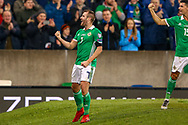 Northern Ireland midfielder Niall McGinn scores a goal and celebrates 1-0 during the UEFA European 2020 Qualifier match between Northern Ireland and Estonia at National Football Stadium, Windsor Park, Northern Ireland on 21 March 2019.