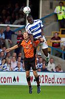 Photo: Daniel Hambury.<br /> Queens Park Rangers v Ipswich. Coca Cola Championship.<br /> 09/08/2005.<br /> QPR's Dan Shittu climbs above Ipswich's Sam Parkin.