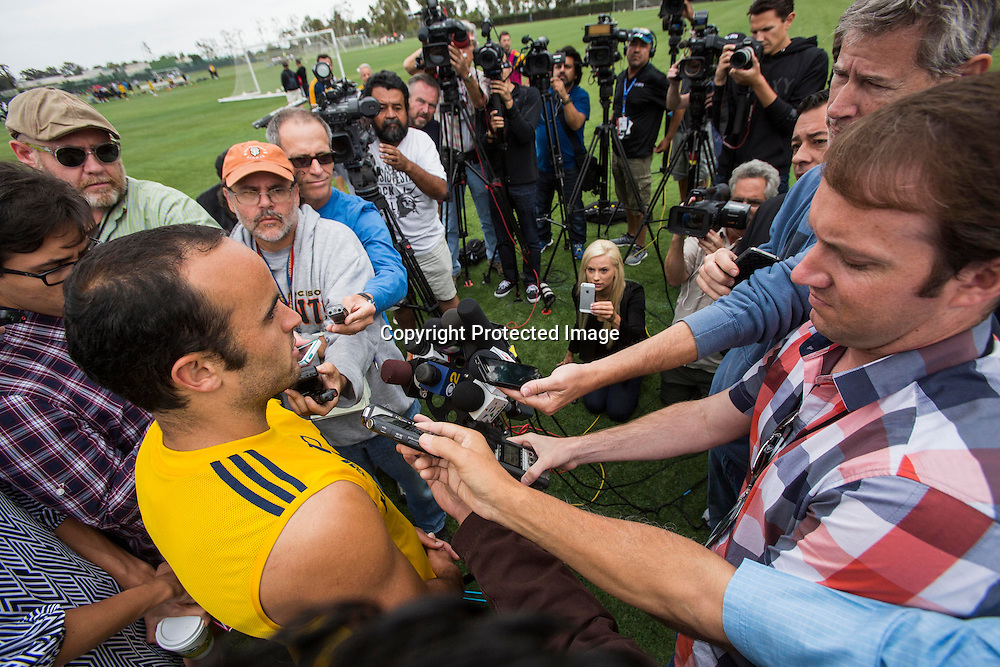 LA Galaxy forward Landon Donovan talks to media during a press conference after a training session at StubHub Center in Carson, Calif., Saturday, May 24, 2014. Donovan, the most accomplished American player in the history of men's soccer, won't be going to his fourth World Cup. The 32-year-old attacker, who set the national team record for goals and assists while winning five titles in Major League Soccer, was among seven players cut Thursday when coach Jurgen Klinsmann got down to the 23-man limit well before the June 2 deadline. (AP Photo/Ringo H.W. Chiu)