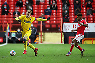 AFC Wimbledon striker Joe Pigott (39) about to pass the ball down the line during the EFL Sky Bet League 1 match between Charlton Athletic and AFC Wimbledon at The Valley, London, England on 12 December 2020.