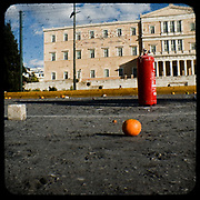 The greek parliament after a riot during the 2008 Athens riots. <br /> <br /> Following the murder of a 15 year old boy, Alexandros Grigoropoulos, by a policeman on 6 December 2008 widespread riots, protests and unrest followed lasting for several weeks and spreading beyond the capital and even overseas<br /> <br /> When I walked in the streets of my town the day after the riots I instantly forgot the image I had about Athens, that of a bustling, peaceful, energetic metropolis and in my mind came the old photographs from WWII, the civil war and the students uprising against the dictatorship. <br /> <br /> Thus I decided not to turn my digital camera straight to the destroyed buildings but to photograph through an old camera that worked as a filter, a barrier between me and the city.