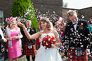 Sara & Craig showered with Confetti
