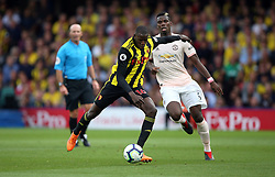 Watford's Abdoulaye Doucoure (left) and Manchester United's Paul Pogba battle for the ball during the Premier League match at Vicarage Road, Watford