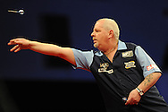 Robert Thornton (Scot) in action against Adrian Lewis(Eng). McCoy's Premier league darts, week 7 event at the Motorpoint Arena in Cardiff, South Wales on Thursday 21st March 2013. pic by Andrew Orchard, Andrew Orchard sports photography,