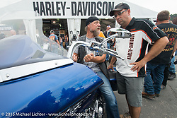 Dean Patelli checks out a new Harley with the help of HD's Charley Lamb at the Harley-Davidson display during the 75th Annual Sturgis Black Hills Motorcycle Rally.  SD, USA.  August 4, 2015.  Photography ©2015 Michael Lichter.