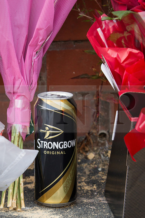 © Licensed to London News Pictures . 12/07/2013 . Manchester , UK . Can of Strongbow . Flowers and tributes at the scene on 5 Beard Road , Gorton , Manchester , for Jordan Begley , who died on Wednesday evening (10th July 2013) after a taser was used on him by police . Police reported the incident , which has been referred to the IPCC , occurred at 20:15 after they responded to a disturbance involving a man with a knife . Photo credit : Joel Goodman/LNP
