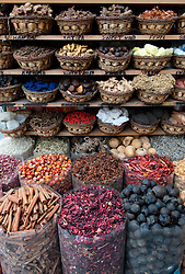 Many exotic spices for sale on stall in the Spice Souq in Deira Dubai United Arab Emirates UAE