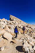 Hikers passing the Keeler Needes on the Mount Whitney trail, Sequoia National Park, Sierra Nevada Mountains, California USA