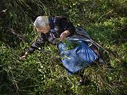 Vangelio Tsimbragou picking wild herbs to cook with. In and around Meronas village, Central Crete.