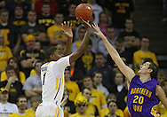 December 07 2010: Iowa Hawkeyes forward Melsahn Basabe (1) puts up a shot over Northern Iowa Panthers forward Jake Koch (20) during the first half of their NCAA basketball game at Carver-Hawkeye Arena in Iowa City, Iowa on December 7, 2010. Iowa defeated Northern Iowa 51-39.