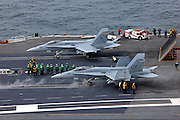A pair of Boeing F/A-18C Hornets, AC 312 165174 from VFA-37 'Bulls' and AC 210 164971 from VMFA-312 'Checkerboards' prepare to catapult off the deck of CVN-75 USS Harry S. Truman for a mission.