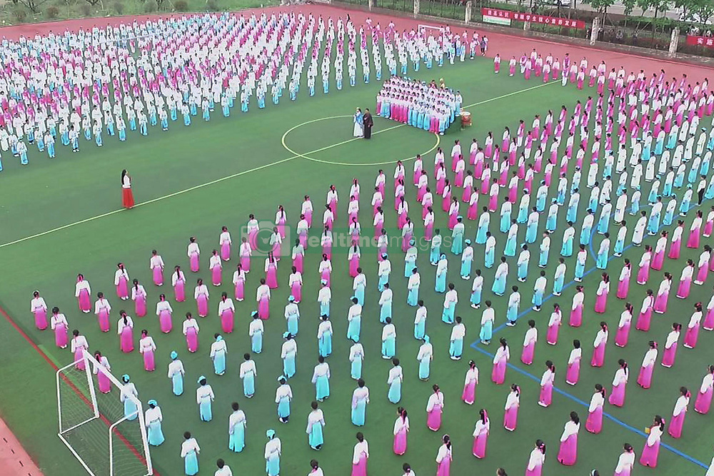 November 10, 2018 - Lianyungang, Lianyungang, China - Lianyungang,CHINA-More than one thousand and two hundred pupils recite traditional Chinese poems at a primary school in Guanyun County, Lianyungang, east China's Jiangsu Province. (Credit Image: © SIPA Asia via ZUMA Wire)