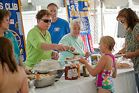 Folks enjoy a BBQ lunch provided by Kiwanis volunteers in honor of the 70th anniversary celebration for the Kiwanis Pool in St. Johnsbury Vermont.  Karen Bobotas / for Kiwanis International