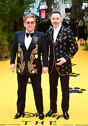 Elton John and David Furnish attending Disney's The Lion King European Premiere held in Leicester Square, London.