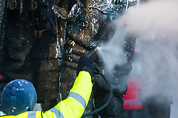 Specialist clean-up workers use high pressure steam to clean the paint vandals squirted over the Bomber Command Memorial in Green Park in the early hours of Monday 21 January. The operation is expected to take at least a day. London, January 22 2019.