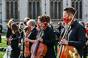 Freelance professional musicians wearing face protective masks and keeping social distance are gathered to perform a two-minute silence for the Let Music Live campaign, raising awareness of the need for targeted support for freelance musicians during the coronavirus pandemic and calling on the Government to recognise that freelance musician is an economic asset. The performance was concluded in Parliament Gardens, outside the Houses of Commons in London, on Tuesday, Oct 6, 2020.  Musicians in Britain are using their voices and instruments to protest against the government instructions to retrain and lack of support to the industry. (VXP Photo/ Vudi Xhymshiti)
