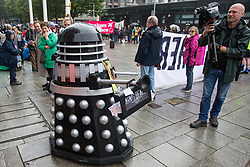 London, UK. 14th September, 2021. A Stop The Arms Fair activist operates a Dalek during protests outside ExCeL London on the first day of the DSEI 2021 arms fair. Activists from a range of different groups have been protesting outside the venue for one of the world's largest arms fairs for over a week.