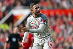 Liverpool's Jordan Henderson reacts during the match