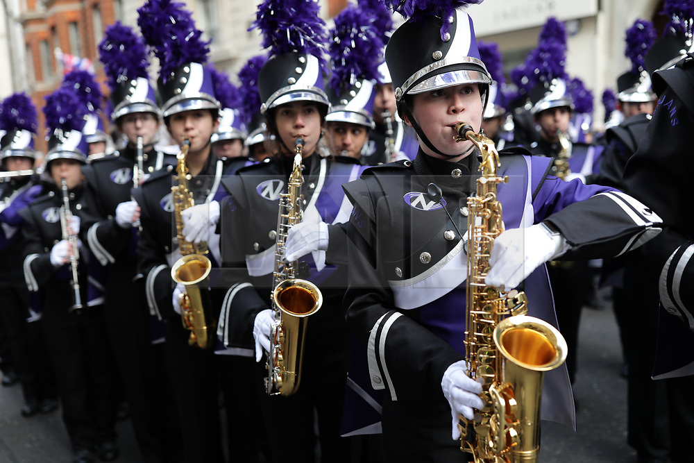 © Licensed to London News Pictures. 01/01/2019. London, UK. The Downers Grove North High School Trojan Marching Band prepare atvtye start of the London New Year's Day Parade. More than 8,000 performers from 26 countries are taking part in the parade. Photo credit: Rob Pinney/LNP