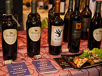 """A lineup of """"reds"""" at the Bogle table accompanied by selections from Common Man restaurants during the Winnipesaukee Wine Festival at Church Landing Thursday evening.  (Karen Bobotas/for the Laconia Daily Sun)"""