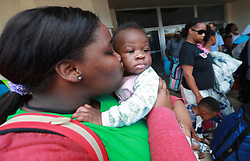 Verida Hemphill gives her neice Laniyah Harsey a kiss on the cheek to comfort her as hundreds of local residents board buses at Lanier Plaza to evacuate the area under mandatory evacuation ahead of Hurricane Dorian for a inland shelter in Columbus on Monday, September 2, 2019, in Brunswick, Ga. Photo by Curtis Compton/Atlanta Journal-Constitution/TNS/ABACAPRESS.COM  | 697831_005 St. Mary's Etats-Unis United States