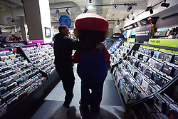 © licensed to London News Pictures. London, UK 29/11/2012. A Super Mario mascot being taken to the launch of Nintendo's latest gaming console, Wii U at HMV Store in Oxford Street, London. Photo credit: Tolga Akmen/LNP