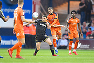Luton Town player Elliot Lee and AFC Wimbledon player Anthony Hartigan fight for the ball in the first half during the EFL Sky Bet League 1 match between Luton Town and AFC Wimbledon at Kenilworth Road, Luton, England on 23 April 2019.
