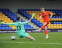 Football - 2020 /2021 Sky Bet League One - AFC Wimbledon vs Portsmouth - Plough Lane<br /> <br /> Harvey White of Portsmouth shoots past Nik Tzanev of Wimbledon  <br /> <br /> Credit : COLORSPORT/ANDREW COWIE