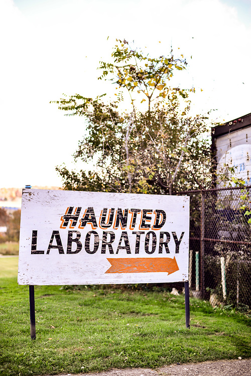 Sign to the entrance of the Haunted Schoolhouse & Haunted Laboratory during the Halloween season.