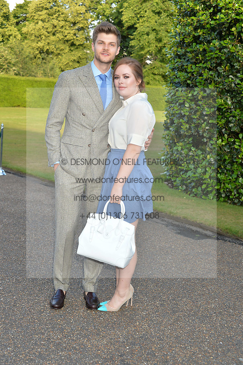 JIM CHAPMAN and TANYA BURR at The Ralph Lauren & Vogue Wimbledon Summer Cocktail Party at The Orangery, Kensington Palace, London on 22nd June 2015.  The event is to celebrate ten years of Ralph Lauren as official outfitter to the Championships, Wimbledon.