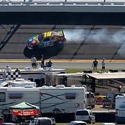 Sprint Cup Series driver Kyle Busch (18) spins during the Daytona 500 Sprint Cup Race at Daytona International Speedway on February 20, 2011 in Daytona Beach, Florida. (AP Photo/Alex Menendez)