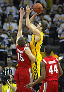January 27, 2010: Iowa guard Eric May (25) puts up a shoot over Ohio State center Kyle Madsen (15) during the first half of their game at Carver-Hawkeye Arena in Iowa City, Iowa on January 27, 2010. Ohio State defeated Iowa 65-57.