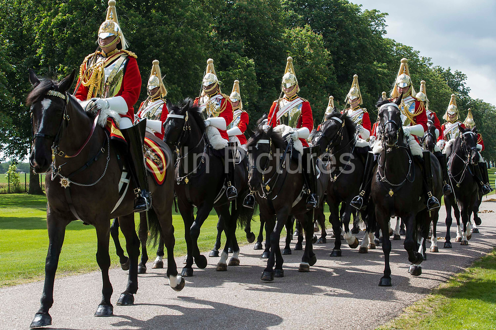 The Household Cavalry Mounted Regiment proceeds along the Long Walk for the ceremony of Trooping the Colour at Windsor Castle to mark the Queens official birthday on 12th June 2021 in Windsor, United Kingdom. A socially distanced and scaled down Trooping the Colour ceremony is taking place this year incorporating many of the elements from the annual ceremonial parade on Horse Guards, with F Company Scots Guards Trooping the Colour of the 2nd Battalion Scots Guards in the Castle Quadrangle.