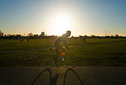 © Licensed to London News Pictures 26/02/2021.        Blackheath, UK. A cyclist. People get out of their homes from a third national Coronavirus lockdown to enjoy some bright sunny weather on Blackheath Common, London. Photo credit:Grant Falvey/LNP